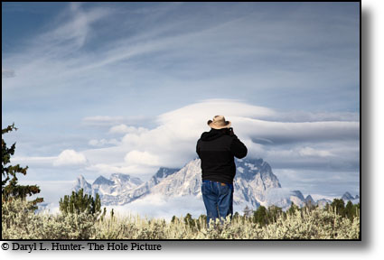 Lenticular clouds, photographer, Grand Tetons, Grand Teton National Park, Jackson Hole, Wyoming