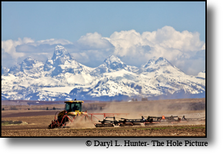 agriculture, Ashton, Idaho, farmer plowing field, Grand Tetons