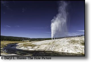 Yellowstone Park's Behive Geyser and the Firehole River