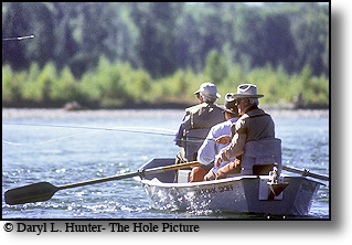 broadcasting legand Curt Gowdy and fly-fishing legand Lee Wolf fishing the Snake River in Jackson Hole, Wyoming