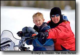 Mother son on snowmobile, island Park, Idaho